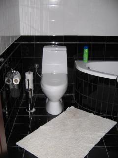 Stylish bathroom with corner bath