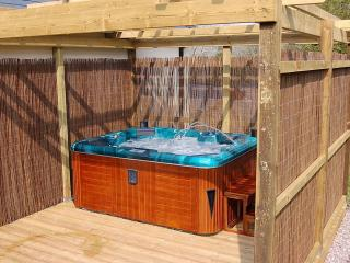 The brand new hot tub sits 5 guests