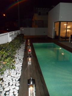 The pool area looking magical at night