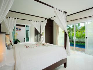 Master bedroom with top quality bed and linen
