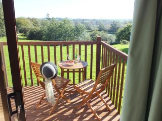 All lodges have South-facing private balconies with views across the fishing lake to the countryside