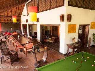 overview of the wooden balcony, dining area and pool table