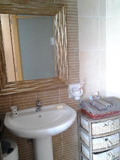 Bathroom area with bath with glass and used as shower all brand new.