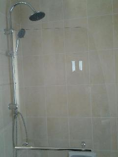 Shower cubicle is part of Bath . Can be used to take a bath or shower . High pressure water system .