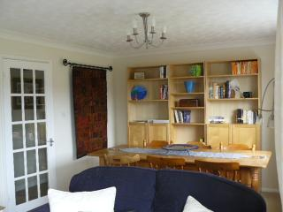 Lounge showing Dining area and bookcase