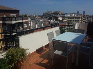 Terrace with city and sagrada familia view