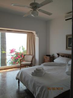 Master bedroom with queen size bed. Wonderful view of the Mediterranean Sea. Extra  chair/bed.