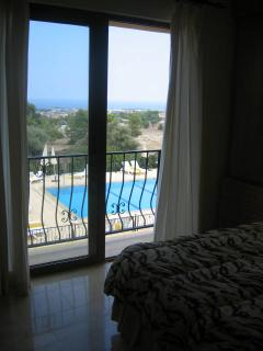 Master bedroom view of pool and out to sea