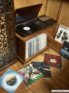 Vintage record deck with a collection of must-have spins for you to enjoy