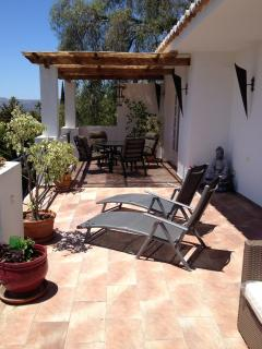 The sun terrace has 2 shaded areas with tables and chairs, or for relaxing there are sun loungers