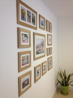 Picture wall with photos from local photographer