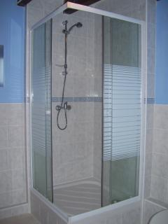 Spacious, modern tiled shower room with an extra large shower enclosure.