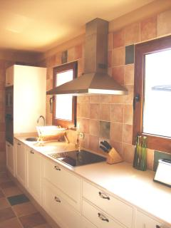 Kitchen equipped with Fridge/Freezer, Microwave, Dishwasher, Plates, Pots and Pans etc