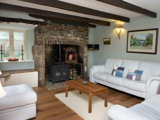 Oak floors and comfortable chairs, relax in front of the fire