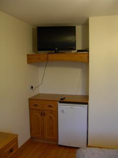 32 inch Smart TV (and fridge) in bedroom 1