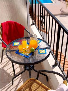 Enjoy breakfast on the lower level balcony