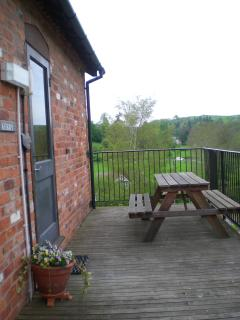 The deck at Kerry Cottage with picnic table and view over the Shropshire Hills AONB,  Aston on Clun.