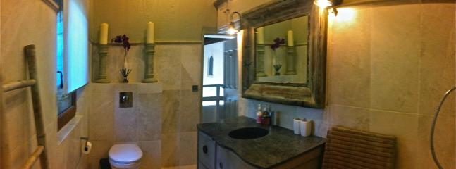 Bastide 1 stone tile bathroom with bath and shower