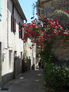 The medieval, fortified village of Camon is adorned with roses and has a 10th century abbey