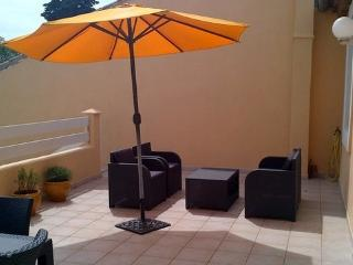 Large sun terrace for relaxing, sunbathing and eating al fresco - barbecue provided