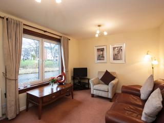 The cosy living room with view of the Water of Leith