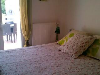 Master double bedroom with kingsize double bed opening onto the terrace
