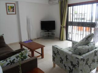 Spacious Living Room with Large Flat Screen TV
