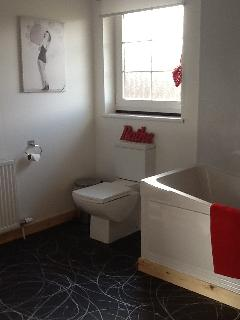 one of the three bathrooms which are all very spacious.