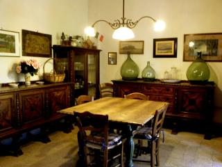 The dining room can sit very comfortably as many as fourteen guests...