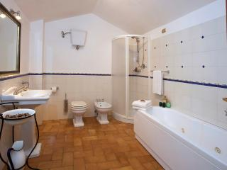 The large bathroom with jetted tub and separate enclosed shower.