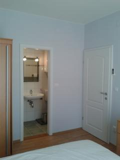 Double bedroom looking toward en-suite shower / toilet