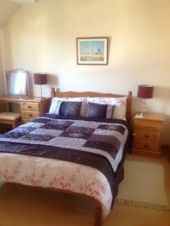 Master bedroom with TV  and DVD player, large wardobe, looks on to Cairngorms