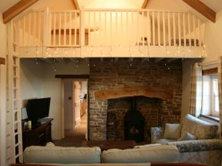 Cosy area with log fire under 'crog loft',TV oak dining table