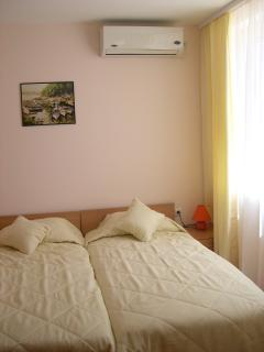 The comfortable and spacious second bedroom (photo belies its size)