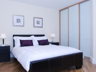 Luxury Master Bedroom with large fitted wardrobes