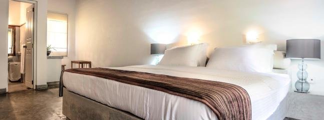 Third Large Double Bedroom with en-suite. Lovely views of the pool and the landscaped garden.