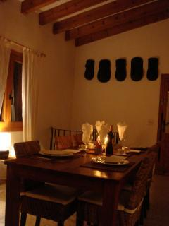 Great dining room, large table, log burner and view over garden and pool.
