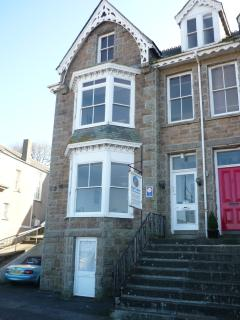 The two bedroom apartment occupies one floor, with the lower bay window