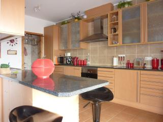 FULLY EQUIPT KITCHEN .UTILITY ROOM END OF KITCHEN