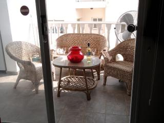 Patio doors from the Lounge take you to a large furnished balcony with views over the swimming pool
