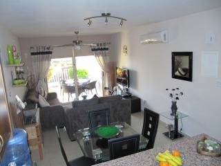 Living area with 42' smart screen TV with full UK Channels / feature movies / karaoke / WiFi et
