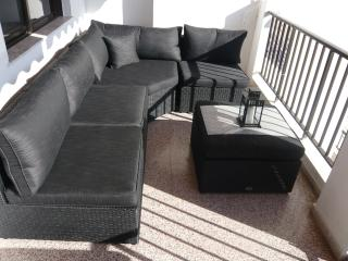 The balcony with a lovely lounge sofa.