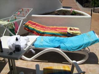 Patio area with own sunbeds