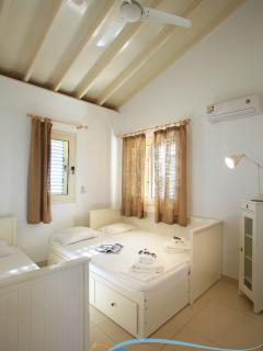 Well-ventilated room suitable for two. One of the two beds can be pulled out to create a double bed.