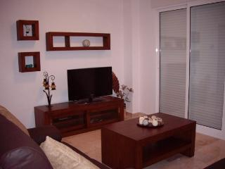 Spacious lounge equipped with tv and dvd player