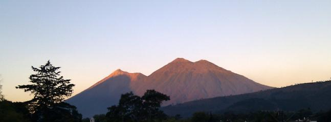 Fuego volcanoe [active!] to the left....middle and right is Acatenango [hike up them if you must!]