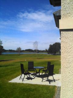 Patio Area With View of Lake and Golf Course