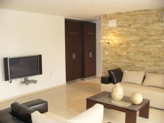 Spacious & comfortable living room with wide screen tv,dvd & ss.