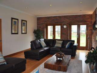 Large lounge with flat screen TV, Sky and DVD