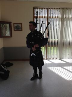 One of our may Pipers in Highland Dress
